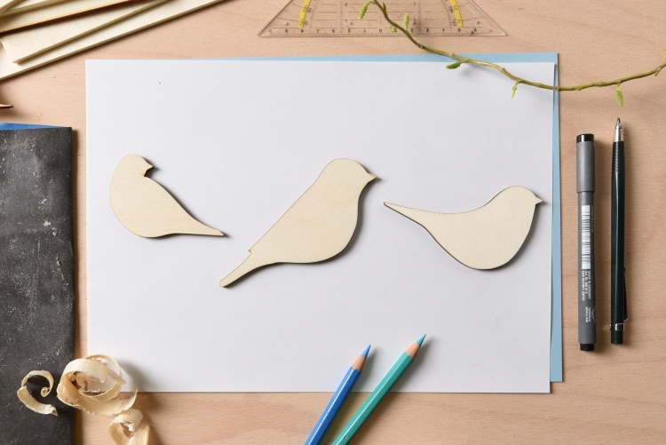 Bird shapes cut from wood using a laser machine