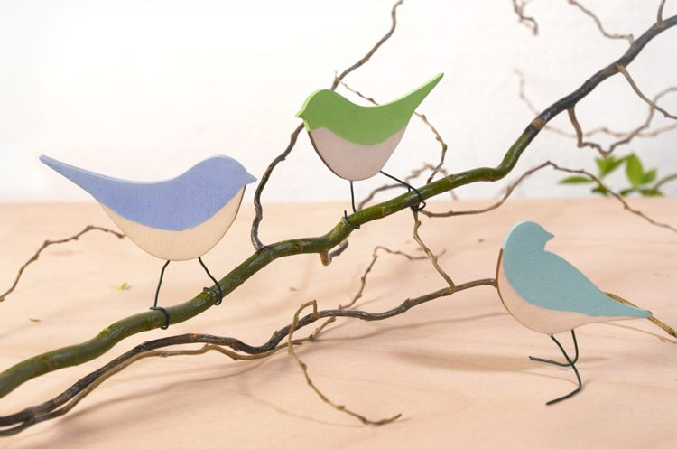 Colorful wooden birds made with a laser cutter