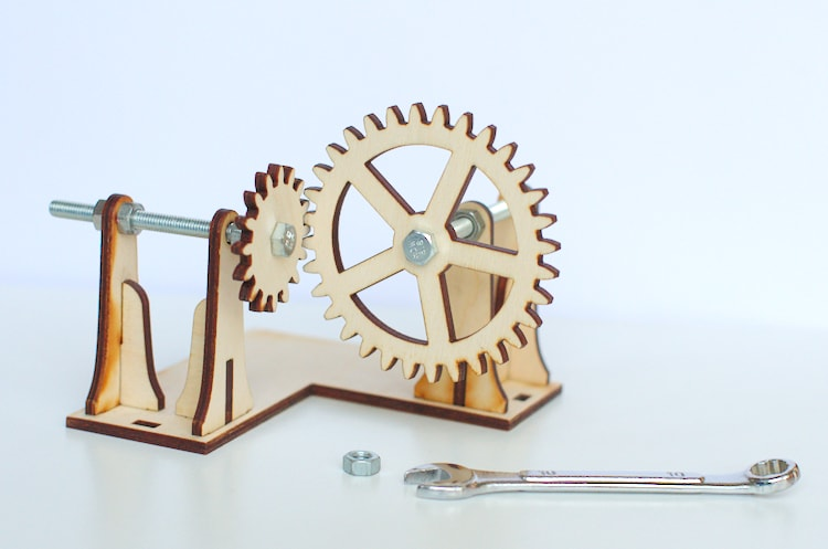 Detail of the laser cut gears showing nuts and bolts used as axle.