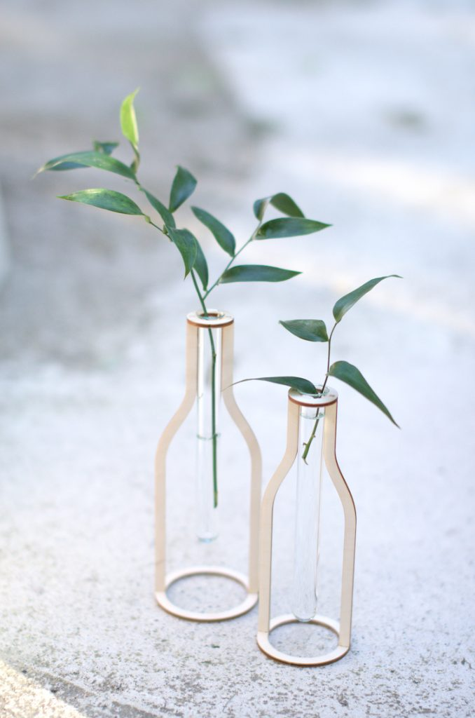 Two wooden test tube vases