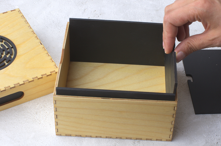 Finishing the bottom of the box with the black inside walls.