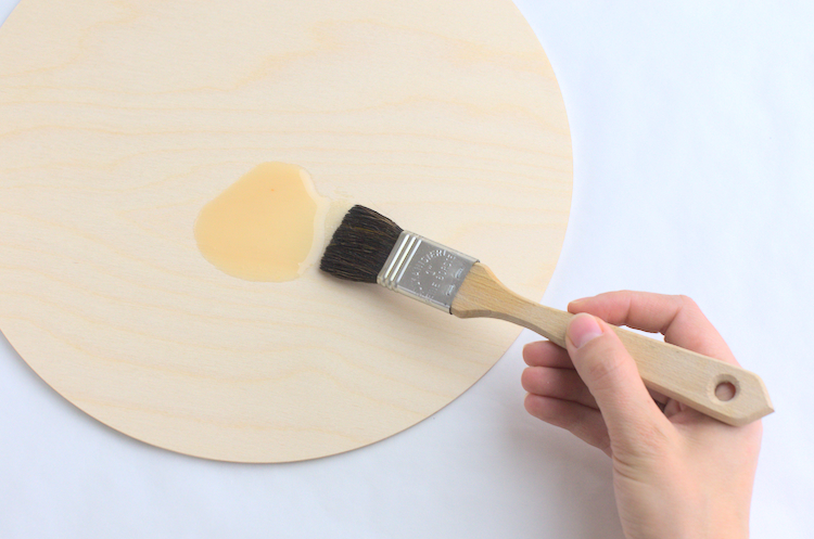 Oiling the wooden sign background