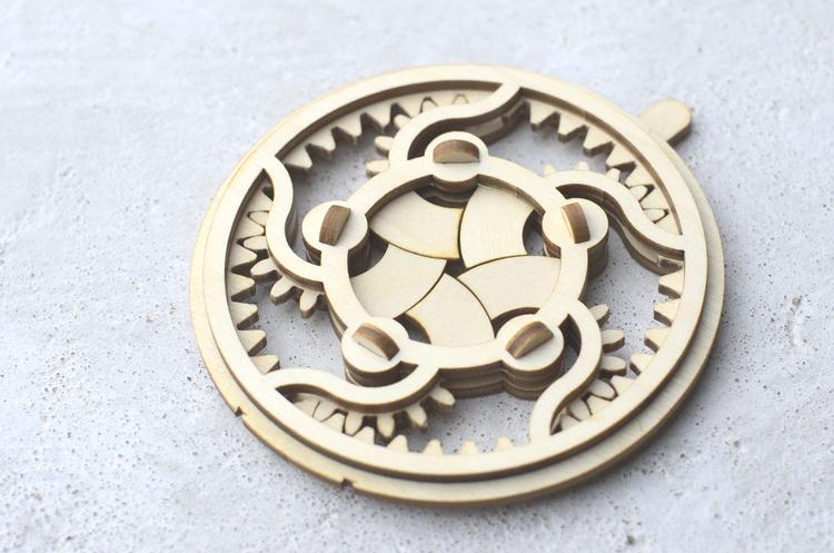 laser cut wooden mechanical iris with geared mechanism